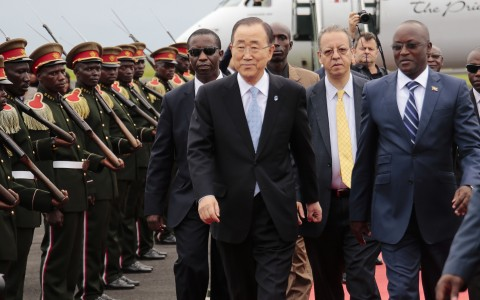UN Secretary-General Ban Ki-moon, middle, walks with Burundian First Vice President, Gaston Sindimwso, right,  as he arrives in Bujumbura, Burundi, Monday, Feb.22, 2016. United Nations Secretary-General Ban Ki-moon is in Burundi to encourage dialogue between the government and its opponents amid violent unrest. (AP Photo/ Gildas Ngingo)