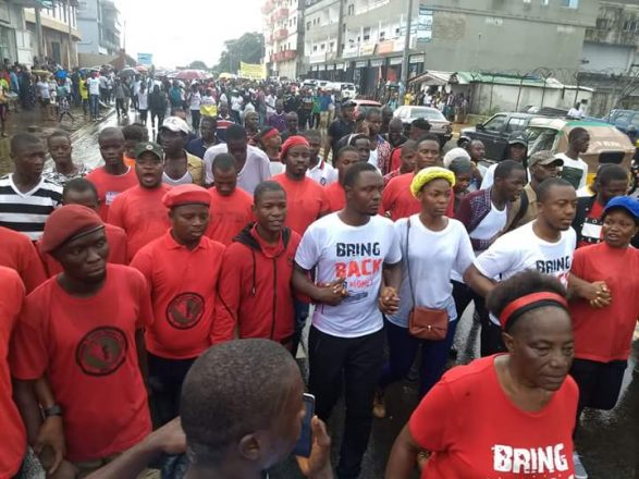 Hundreds of Liberians march in 'Bring Our Money Back' protest