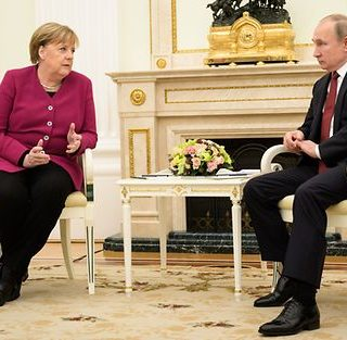 Libya's warring sides accept ceasefire after Putin, Merkel meet