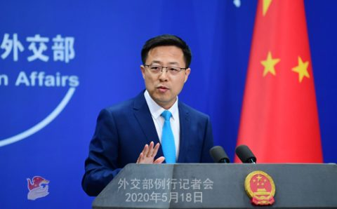 China responds to COVID inquiry resolution, calls U.S. official 'lying blabbermouth'