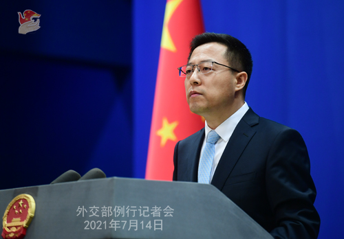 China, glossing its own human rights record, praises UN racism move